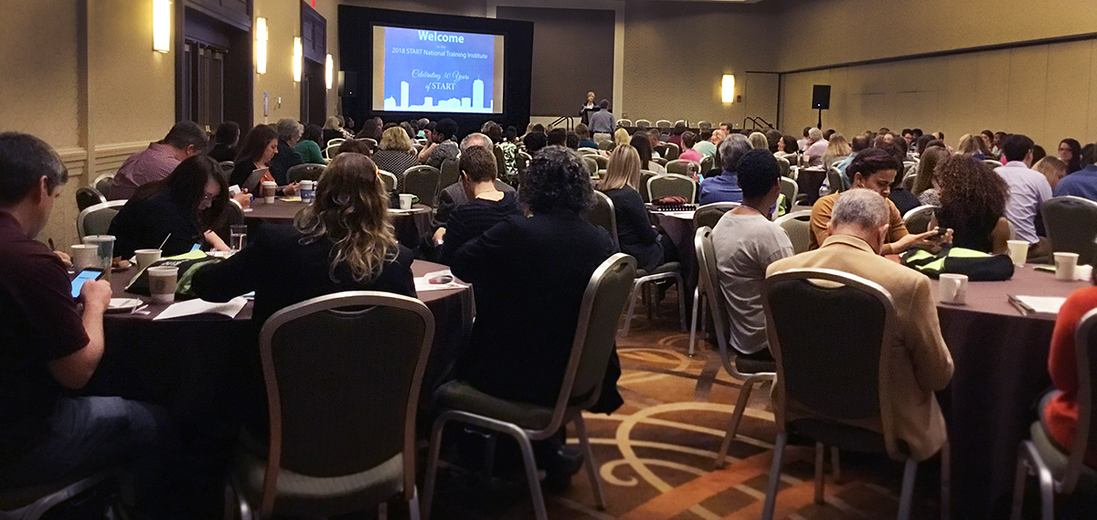 Picture of the Sheraton ballroom filled with attendees during Director Linda Bimbo's welcoming address